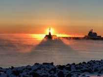 Steam rising from Lake Superior around Canal Park Lighthouse Duluth MN  Photo by geisslereliz