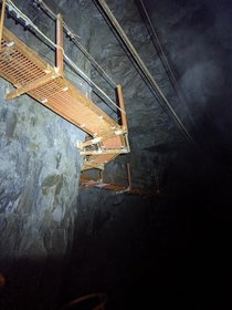 Steel catwalk above a flooded underground chamber
