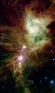 Stellar Snowflake Cluster The newly revealed infant stars appear as pink and red specks toward the center and appear to have formed in regularly spaced intervals along linear structures in a configuration that resembles the spokes of a wheel or the patter