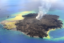 Still Huffing And Puffing Nine months after a new island broke through the surface of the western Pacific Ocean the volcanic eruption at Nishino-shima continues The tiny new volcanic islandmerged into Nishino-shimaand continued to grow Photo by Japan Coas