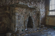 Stone fireplace in an abandoned prison