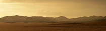 Storm over hills of California gives illusion of a Martian landscape  miles outside of Avenal
