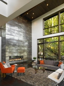 -Story Metallic Fireplace in Contemporary Waterfront Hideaway  Gambier Island BC Canada Turkel Design
