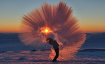 Stunning Shot Captures Man Flinging a Thermos of Hot Tea in Subzero Temperatures