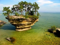 Stunning Turnip Rock Eroded by water over the course of thousands of years this free standing rock is located in Lake Huron - Port Austin Michigan Unknown photographer