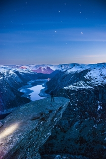 Stunningly beautiful view of Trolltunga at night  Odda Hordaland  Norway