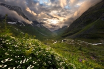 Sun breaking through the clouds over Innerdalen Norway  Photo by Haakon Nygrd