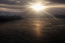 Sun coming through the clouds over Turnagain Arm in Alaska