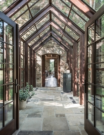 Sun-Dappled Cathedral SunroomHallway in Beautiful Stone Residence  Snake River WY