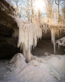 Sun illuminates the ice formations around Carpenter falls in Moravia NY