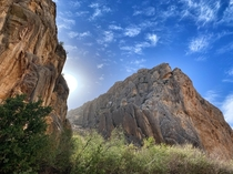 Sun peeking out from behind the walls of Dog Canyon in Big Bend National Park in Texas