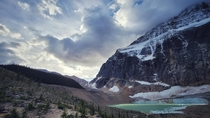 Sun peeking through early morning clouds at Mount Edith Cavell Jasper National Park Canada