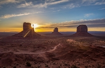 Sun peeking through Monument Valley Utah