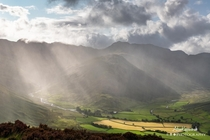 Sun rays cutting through the rain in the Langdale Valley The Lake District