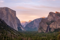 Sun rays hitting the tip of Half Dome Wallpaper material from TunnelView Yosemite National Park CA