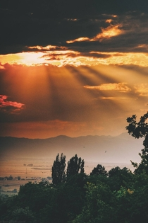 Sun rays over my home town in Bosnia during Summer Cant wait to roam these Livno hills again