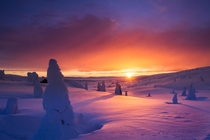 Sun rises over the snow in Norway
