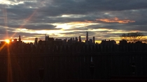 Sun Setting Behind the Manhattan Skyline Taken From a Roof in Brooklyn