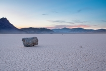 Sun setting on the sailing stones of Racetrack Playa in Death Valley NP  IG alexkendig
