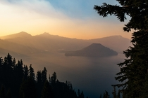 Sun setting through a layer of smoke two summers ago at Crater Lake National Park