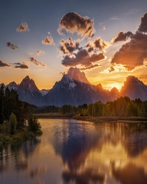 Sun shining through the mountains in Grand Teton National Park Wyoming USA