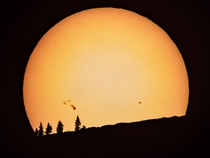 Sun with Sunspots Visible Setting Over a Mountain in Northern California Through My Telescope