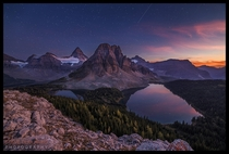 Sunburst Serenity - the final burst of light as the sun sets over Mount Assiniboine Provincial Park Canada  by Steve Dublanko