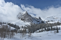 Sundial Peak emerging from the clouds UT