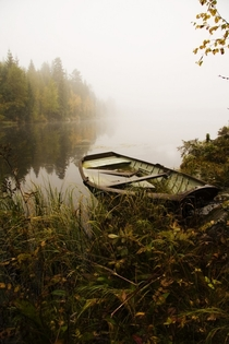 Sunken boat in lake Lpsjen