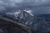 Sunlight on Half Dome during a thunderstorm