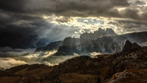 Sunlight Peeking through the Clouds near Croda da Lago Italian Dolomites  by ubo Balaovi