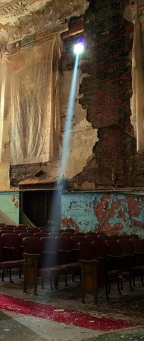 Sunlight streams through a broken window in an old vaudeville theater Detroit Michigan