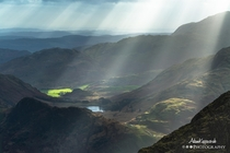 Sunrays over Blea Tarn from the Langdale Pikes The Lake District