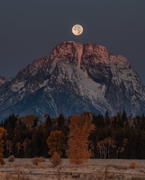 Sunrise and full moonset in the Tetons in October late fall x