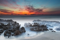 Sunrise at Coral Cove Fl  By Andres Leon