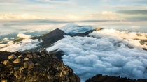 Sunrise at Mount Rinjani in Lombok - m - with its own shadow in the clouds