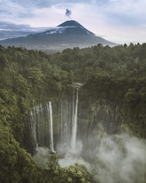 Sunrise at Tumpak Sewu in the background Mt Semeru blows a little smoke East Java