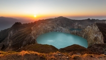 Sunrise atop a volcano Turquoise blue lakes fill the craters of Kelimutu on Flores island Indonesia