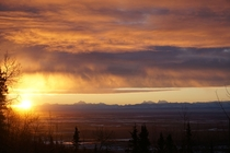 Sunrise behind the Alaska Range
