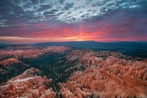 Sunrise colors storm clouds over Bryce Canyon as seen from Bryce Point Photo by Lonnie Shull