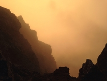Sunrise from inside a cloud while mountaineering in Oregon
