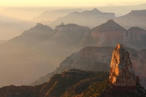 Sunrise from Point Imperial at the Grand Canyon shrouded in smoke from a fire