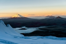 Sunrise from Volcan Antisana looking towards a smoking Cotopaxi