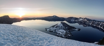 Sunrise hits Wizard Island and Crater Lake after a night spent watching the Milky Way traverse overhead