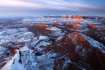 Sunrise in a snow covered desert Dead Horse Point in Utah  by danielbenjaminphoto