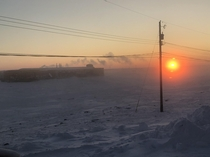 Sunrise in Canadian High Arctic - degrees Celsius in Cambridge Bay Nunavut March   In the picture is the  million dollar Canadian High Arctic Research Station OC