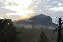 Sunrise in the Black Elk Wilderness Black Hills South Dakota Taken two weeks ago Due to unusually high humidity I woke up in a bank of fog which cascaded off the granite monuments as the sun rose