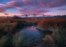 Sunrise just begins to light the peaks of the Eastern Sierra view from the Owens valley CA  Photo by Ted Gore
