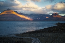 Sunrise light on the Black Cuillin mountains from Elgol Love at first sight Isle of Skye Scotland UK