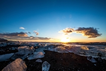 Sunrise on a beach filled with ice Iceland By Jace LeRoy -